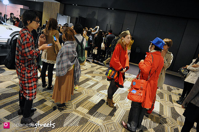 111018-8263: Visitors leave the IN-PROCESS BY HALL OHARA show at the Japan Fashion Week in Tokyo