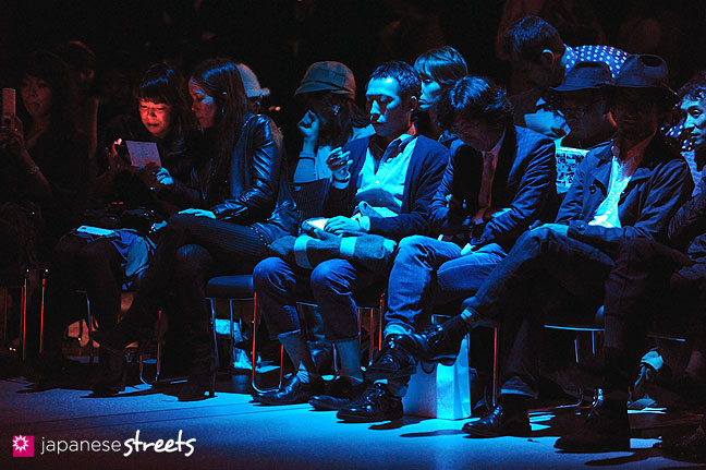 111019-8678: Visitors waiting for a show to begin at the Japan Fashion Week in Tokyo