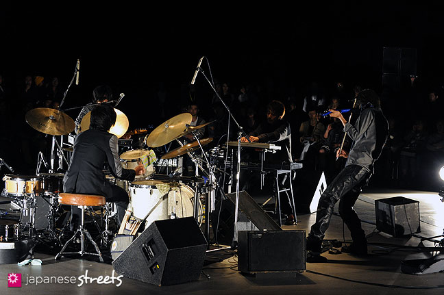111019-8685: A band plays at the Yoshio Kubo show during the Japan Fashion Week in Tokyo