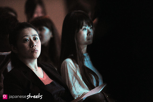 111019-8913: Visitors wait for a show to start at the Japan Fashion Week in Tokyo