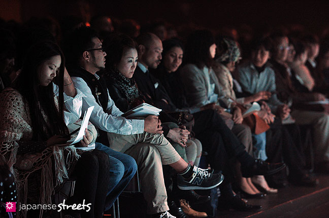 111019-8914: Visitors wait for a show to start at the Japan Fashion Week in Tokyo