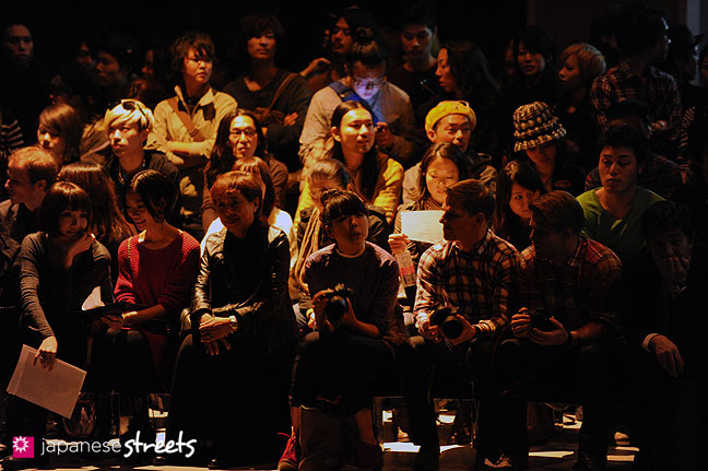 111020-0389: Visitors wait for a show to start at the Japan Fashion Week in Tokyo