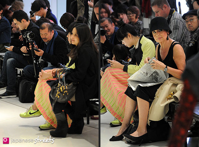 111021-1275-111021-1290: Fashion Essayist Françoise Moréchand (with hat) sitting next to fashion blogger Suzy Lau (in green) at the Japan Fashion Week in Tokyo S/S 2012