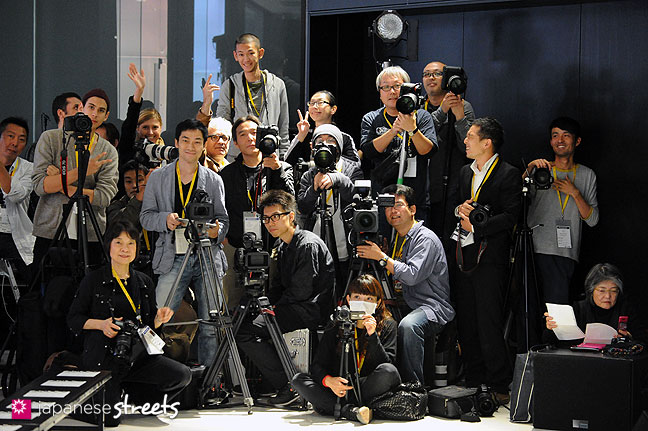 111021-1286: Fashion photographers waiting for the MOLFIC show to start during the Japan Fashion Week in Tokyo S/S 2012