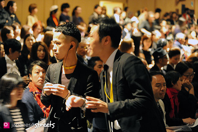 111021-1541: Staff members confer before the start of a fashion show at the Japan Fashion Week in Tokyo