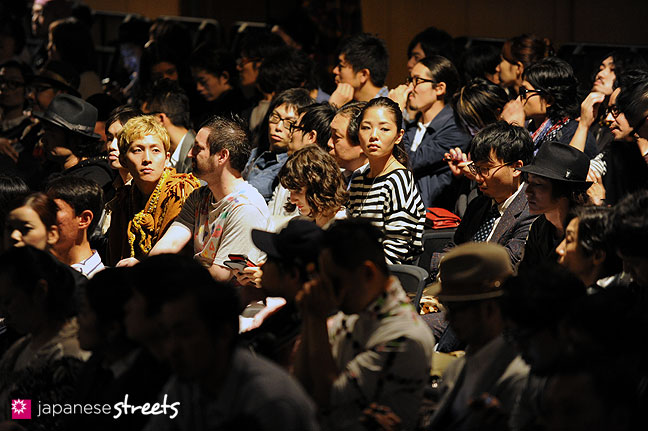 111022-3168: Visitors waiting for a fashion show to start at the Japan Fashion Week in Tokyo