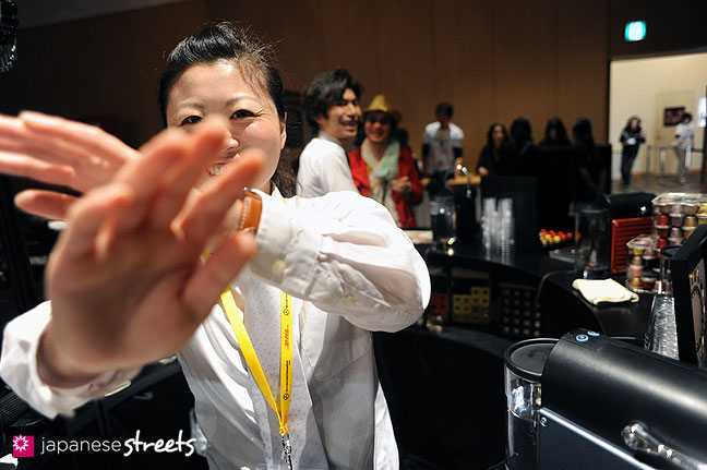 111022-3907: A shy staff member of the espresso booth during the Japan Fashion Week in Tokyo