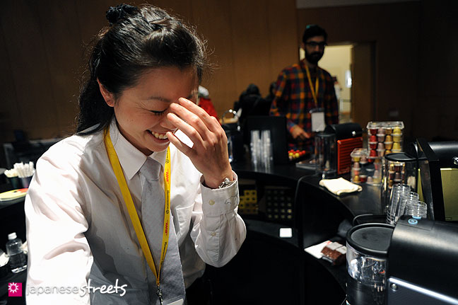 111022-3912: A shy staff member of the espresso booth during the Japan Fashion Week in Tokyo