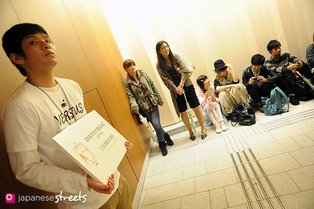 111022-3920: People wait for the mastermind show during the Japan Fashion Week in Tokyo