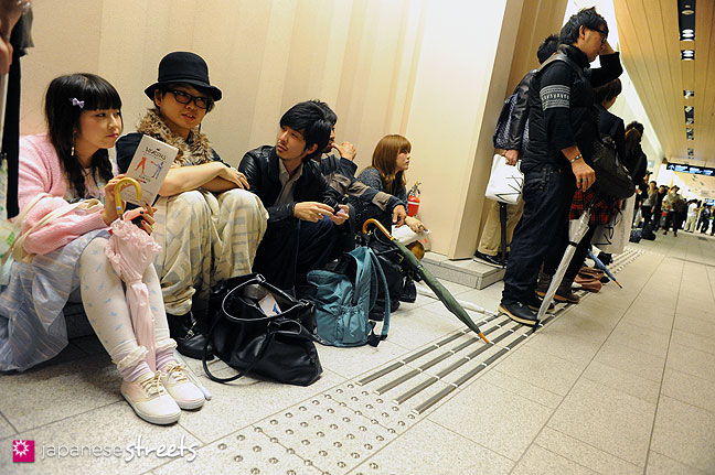 111022-3922: People wait for the mastermind show during the Japan Fashion Week in Tokyo