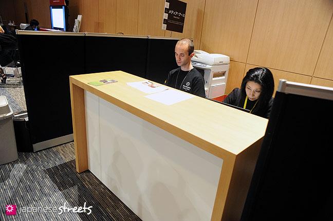 111017-5730: Information counter at the Japan Fashion Week Media Lounge